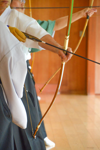 Japan Japanese  Martial Arts Arts Bow And Arrow Budo Close-up Focus On Foreground Holding Human Hand Kyudo One Person People Real People