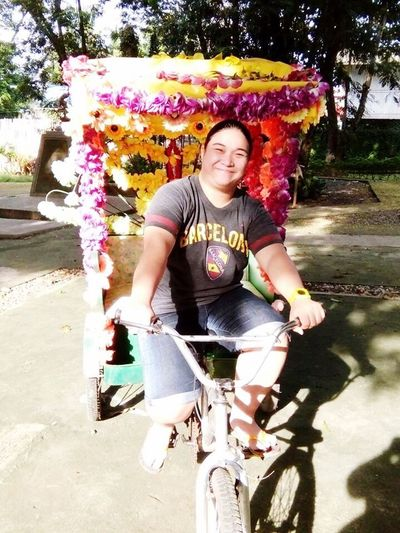 Bike Looking At Camera One Person Casual Clothing Day Outdoors Smiling Flowers Flowered Bike Connected By Travel
