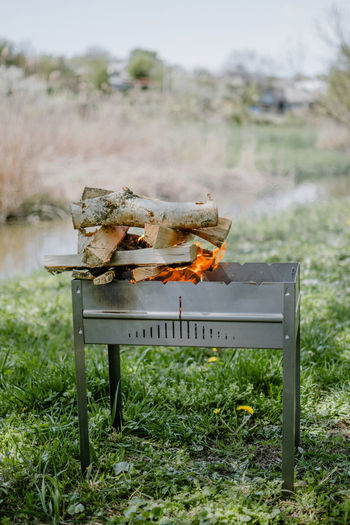 View of burning firewood on grill
