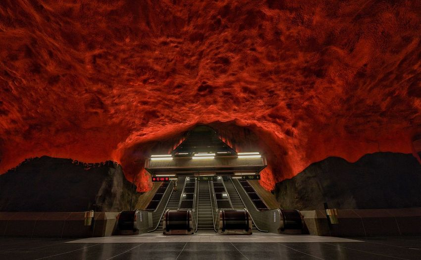 Stockholm Subway Solna Station Industrial Concrete Architecture Escalator Red Color Public Transportation Stockholm Subway Station Subway Architecture Transportation No People Built Structure Illuminated Night Mode Of Transportation Red Arch Travel Destinations Tunnel