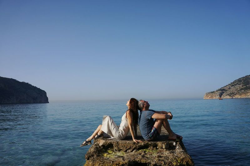 Two People Adults Only Adult Togetherness Sea Young Women People Young Adult Relaxation Only Women Clear Sky Beach Beauty In Nature Nature Outdoors Day Sky Human Body Part Mallorca