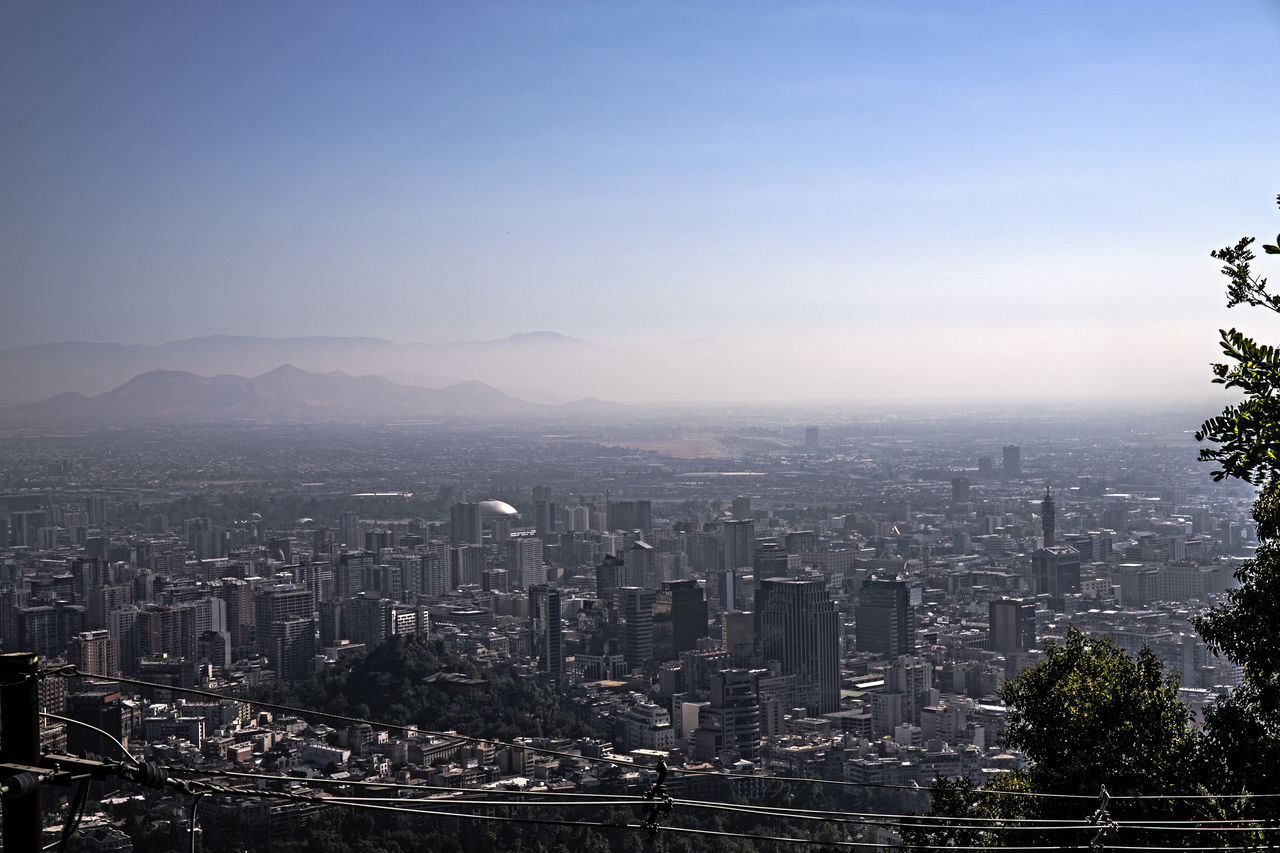 cityscape, architecture, building exterior, skyscraper, city, built structure, crowded, modern, travel destinations, outdoors, sky, clear sky, day, urban skyline