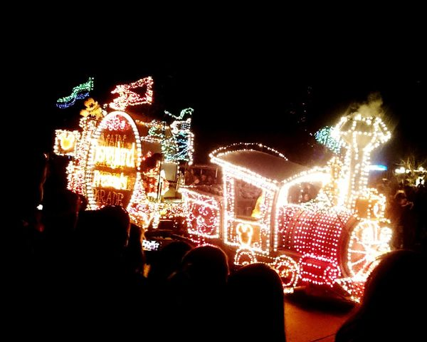 Electricity, bright lights, colorful lights, Illuminated Multi Colored Amusement Park Christmas Lights Night Arts Culture And Entertainment Celebration Christmas Decoration Christmas Outdoors Holiday - Event People