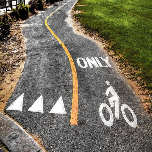 Asphalt Bicycle Bike Country Road Day Diminishing Perspective Directional Sign Empty Grass Information Sign No People Outdoors Path Pathway Road Road Marking Road Sign The Way Forward Transportation Vanishing Point Virginia Beach