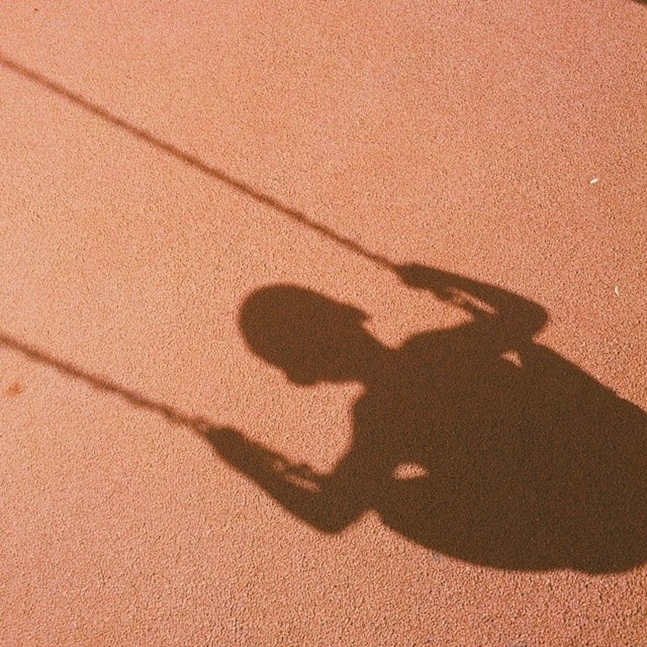 Shadow on a boy swinging