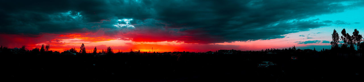 Beauty In Nature Cloud - Sky Dark Dramatic Sky Environment Landscape Nature No People Ominous Outdoors Overcast Panoramic Pollution Power In Nature Scenics - Nature Silhouette Sky Storm Storm Cloud Sunset Tranquil Scene Tree