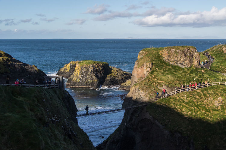 Carrick-a-Rede Rope Bridge, County Antrim Atlantic Ocean Ireland Rope Bridge United Kingdom Beauty In Nature Bridge Built Structure Cloud - Sky Day Horizon Horizon Over Water Land Nature Outdoors Rock Rock - Object Rock Formation Scenics - Nature Sea Sky Tranquil Scene Tranquility Uk Ulster Water
