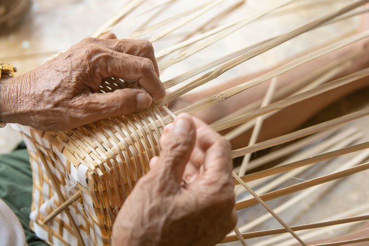 Close-up of woman hand holding basket