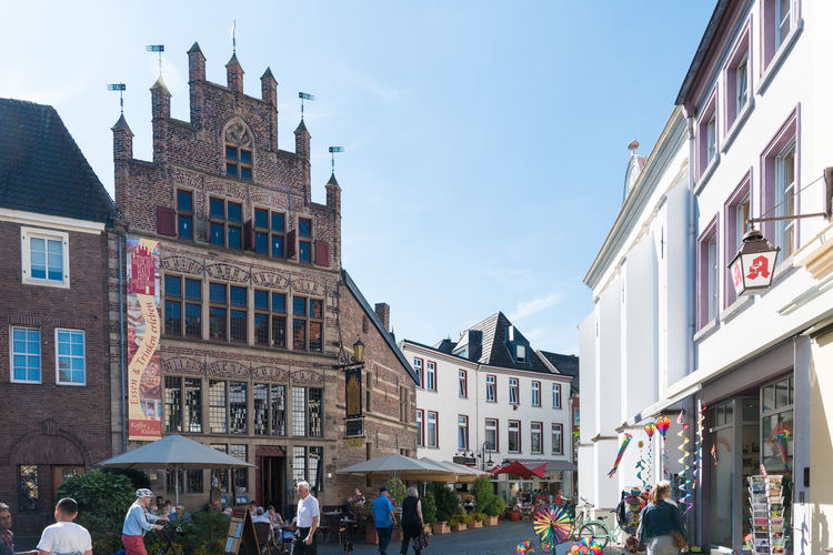 XANTEN, GERMANY - SEPTEMBER 07, 2016: Unidentified Individuals stroll along one of the shopping streets in downtown A Blue Sky Castel Cathedral Downtown Germany History Medieval Photography Place To Visit Roman Tour Touristic Attratio Xanten