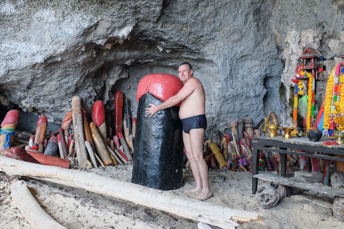 Fertility temple aka phallus shrine at Phra Nang beach, Krabi province, Thailand. Adult Adventure Cave Day Extreme Sports Fertility Horizontal Krabi Luck Member One Man Only One Person Only Men Only Women Outdoors People Person Phallic Phallus  Phranang Shrine Symbolism Temple Tourism Tourist