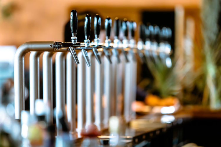 Close-up of faucets in bar