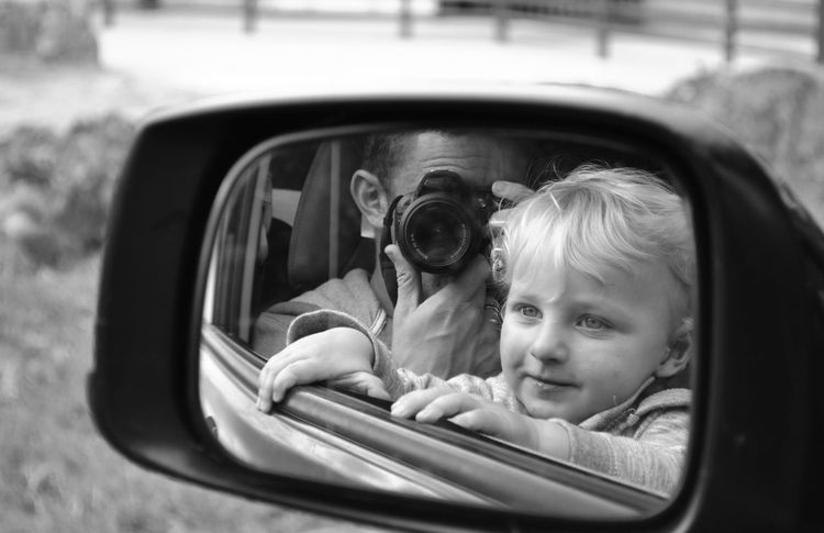 Reflections Boy Family Nikonphotography Nikon EyeEm Best Shots - Black + White EyeEm Best Shots Childportrait Vehicle Father & Son Son Cute Childhood Mirror Blackandwhite Photography Blackandwhite Childhood Car Child Mode Of Transportation Motor Vehicle Land Vehicle Transportation Real People Reflection Portrait Headshot Side-view Mirror Innocence Glass - Material