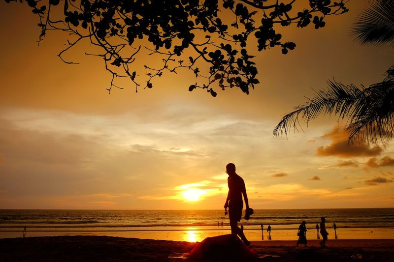 Sunset time Beach Sunset Silhouette Sea Vacations Enjoyment Dusk Adult Horizon Over Water Sun Sky Summer Outdoors Nature People Colorful Day Time Holiday♡ Water Reflection Full Length Boys Water's Edge Passing