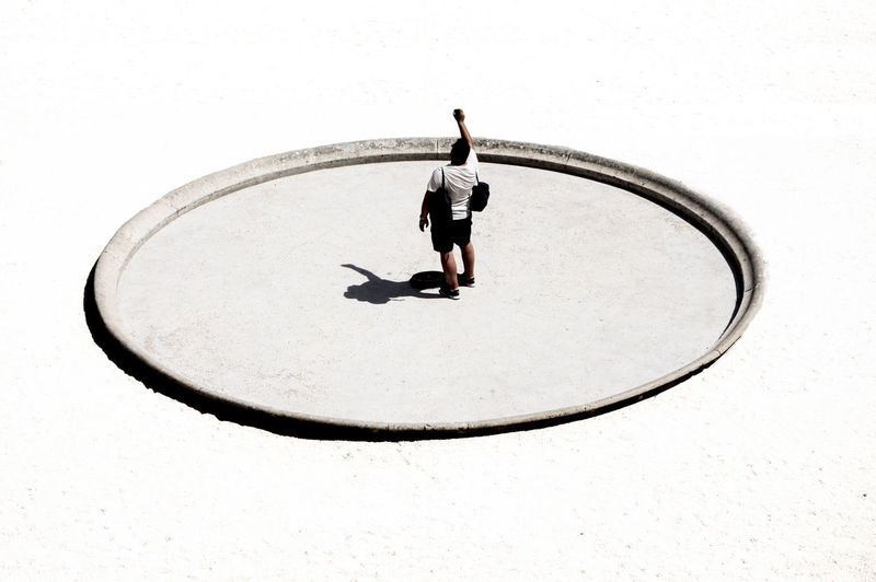 High angle view of man standing on sun dial