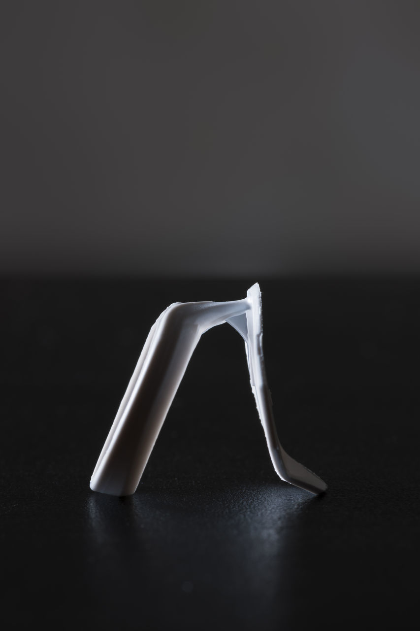 still life, table, no people, indoors, close-up, studio shot, black background, day
