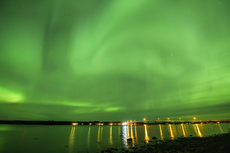 Planet Earth Landscape_photography Sweden Aurora Polaris Aurora Borealis Aurora Auroraborealis Aurora Chasing Northern Lights Water Illuminated Lake Reflection Sky Architecture Green Color Built Structure Star Field Aurora Polaris Astronomy Bridge - Man Made Structure Star - Space Space And Astronomy