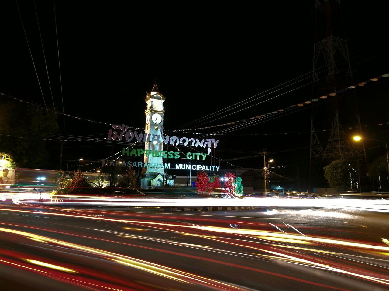 light trail, speed, long exposure, motion, night, blurred motion, illuminated, high street, transportation, urban scene, road, architecture, outdoors, building exterior, no people, clear sky, city