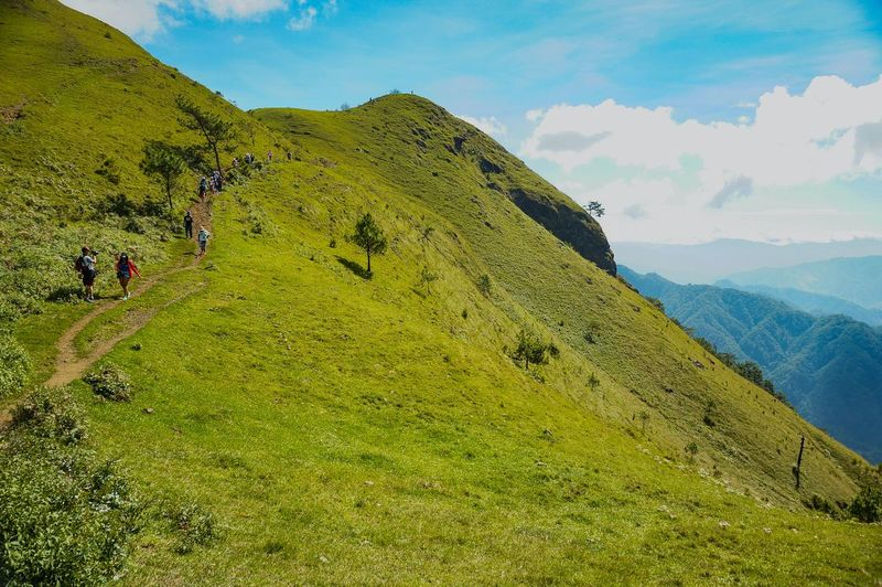 Walking on top Hiking Climbing Mtulap Sun Adventure Philippines Mountain Summit Top Grass Mtulap Sky Terraced Field Hill Tree Men Sky Landscape Travel Farmland Hiker