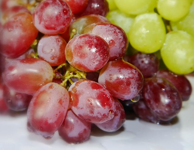 Close-up of fresh red and green grapes
