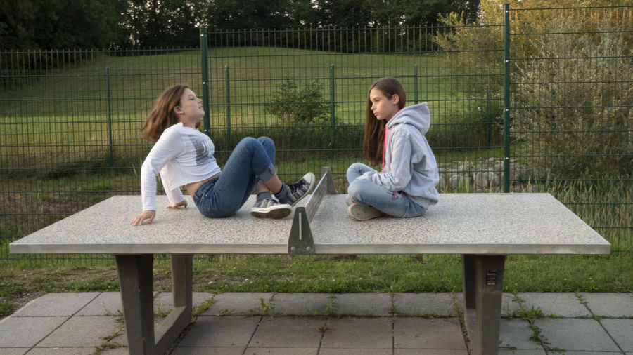 Girls on the table dance gymnastic gym fun first eyeem Photo Adult Bench Casual Clothing Day Fence First Eyeem Photo Full Length Hood - Clothing Leisure Activity Nature Outdoors Plant Relaxation Seat Sitting Table Togetherness Two People Women Young Adult Young Women