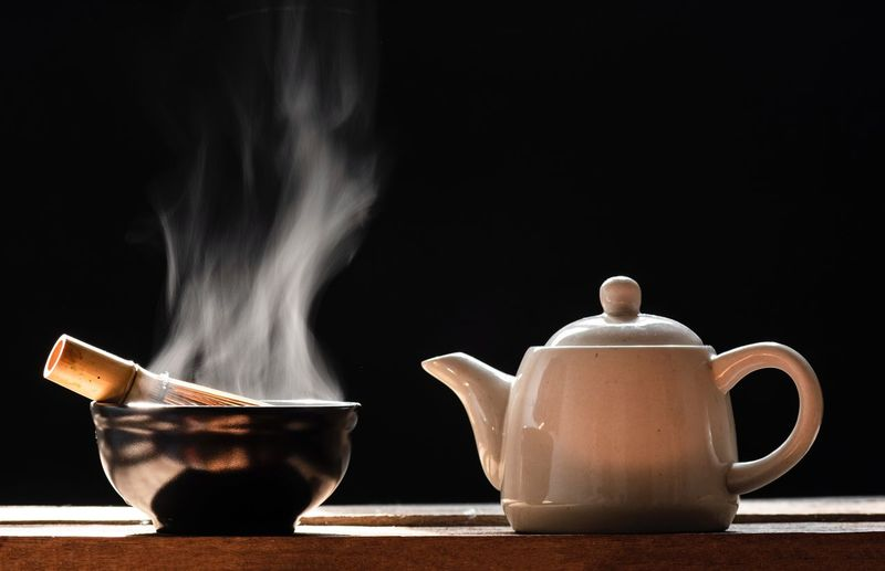 Hot matcha green tea on a black background Hot Hot Drink Smoke Cup Indoors  Mug Table Food And Drink Steam Drink Still Life Coffee Close-up Hot Drink Black Background Coffee - Drink Coffee Cup Smoke - Physical Structure Tea Motion Heat - Temperature