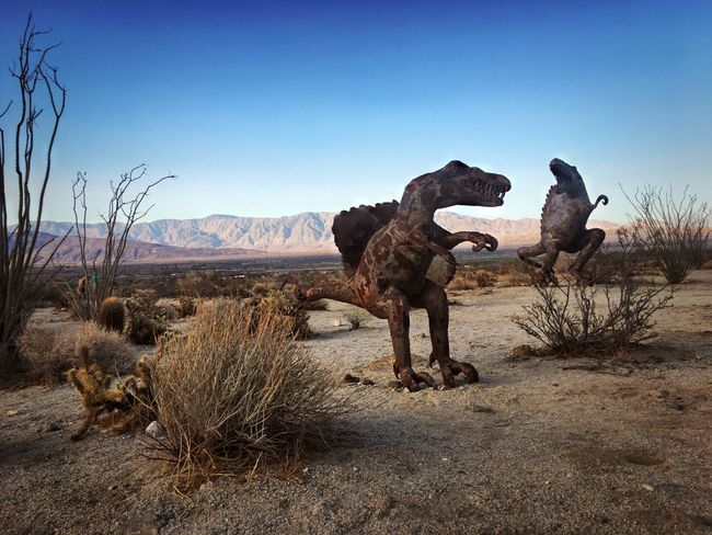 Desert sculptures Metalsculpture Art Sky Clear Sky Nature Mammal Environment Animal The Great Outdoors - 2018 EyeEm Awards Animal Themes No People Landscape Group Of Animals Land Day Mountain Blue Herbivorous Copy Space