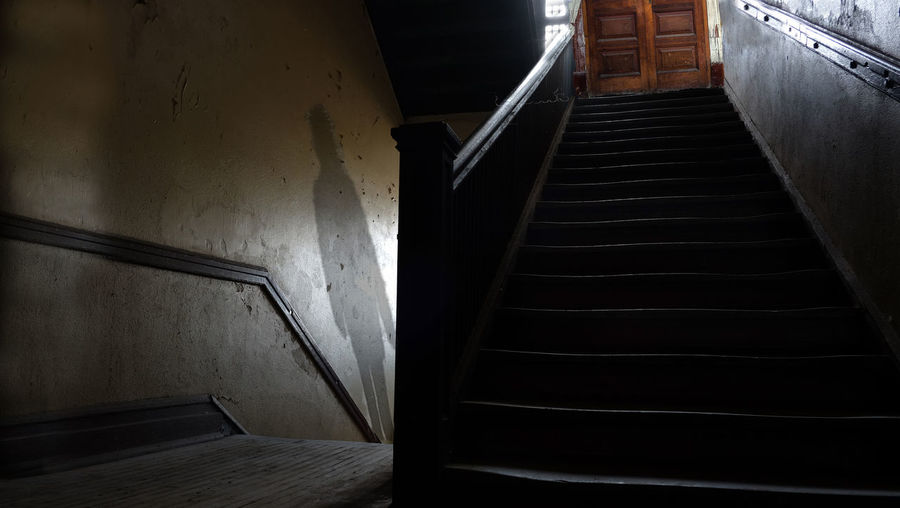 Twilight Stairway Absence Architecture Building Built Structure Dark Direction Door Empty Entrance Indoors  Low Angle View Narrow No People Railing Shadows Staircase Steps And Staircases The Way Forward Wall Wall - Building Feature