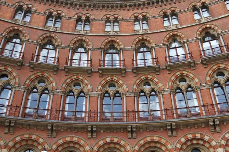 The curved facade and architectural detail of The St Pancras Rennaisance Hotel in London, UK. St Pancras St Pancras Hotel London LONDON❤ Londonstreets Architecture Architecture_collection Architectural Detail Architectural Feature Architecturelovers Façade Facades Facade Building Windows Curve Curves Curves And Lines Curved Buildings Frontage Red Brick Rennaisance Building Building Exterior Buildings Check This Out