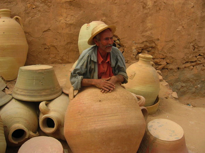 Artisan Sitting Tunisia Amphoras Day Djerba  Hat July 2005 One Person Outdoors Real People