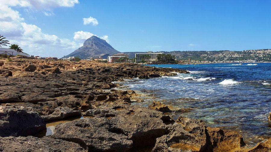 Rocky beach with sky in background
