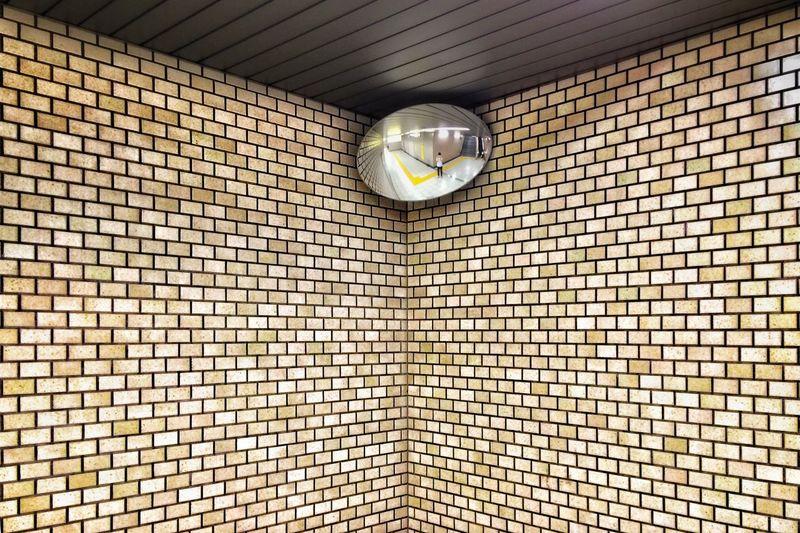 Low angle view of light bulbs hanging on wall