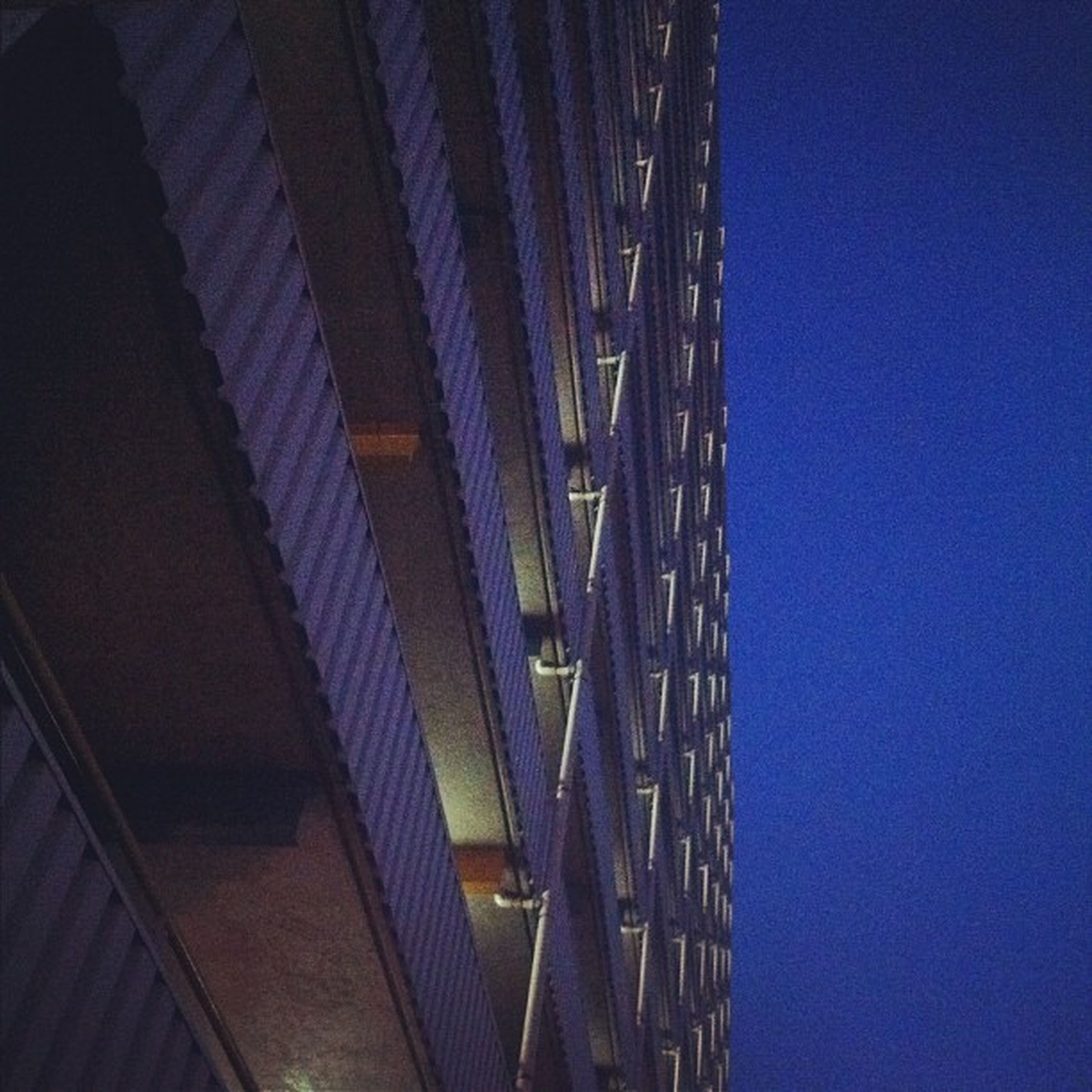 architecture, built structure, low angle view, blue, connection, clear sky, building exterior, bridge - man made structure, illuminated, night, engineering, sky, city, copy space, transportation, outdoors, no people, building, modern, dusk