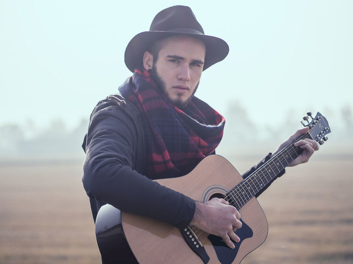 Adult Adults Only Classical Guitar Day Guitar Males  Men Music Musical Instrument Musician Nature One Man Only One Person One Young Man Only Only Men Outdoors People Playing Plucking An Instrument Portrait Sky Young Adult Young Men