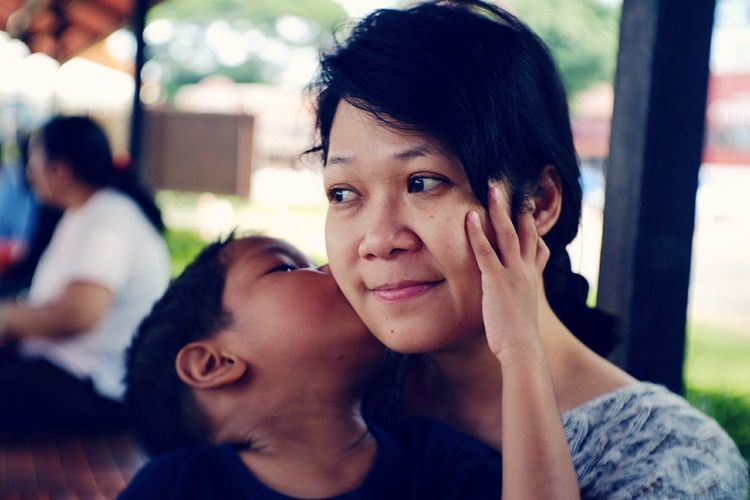 Close-Up Of Son Kissing Mother
