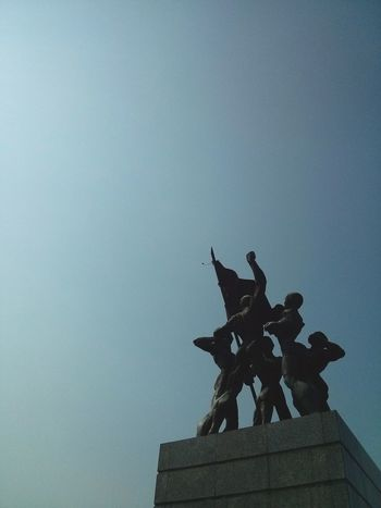 Monument in Jakarta, INDONESIA. · History Monuments Capitals  Upwards Against The Light Blue Sky