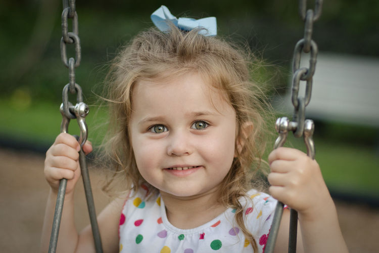 Chain Childhood Close-up Cute Day Front View Girls Happiness Headshot Holding Innocence Looking At Camera One Person Outdoors People Portrait Real People Rope Swing Smiling Swing