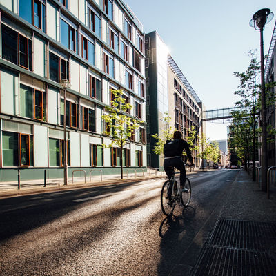 Bicycle riding in the streets of Berlin, Germany, in early morning hours. Against The Sun Anonymous Architecture Bicycle Bike Bright Building Built Structure City City Life Cycling Day Diminishing Perspective Full Length Land Vehicle Leisure Activity Lifestyles Mode Of Transport Morning Morning Sky Outdoors Riding Road The Way Forward Traffic