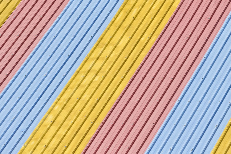 Diagonal Lines Colourful Colours Diagonal EyeEm Best Shots Roof Background Backgrounds Blue Close-up Colorful Design Diagonal Lines Diagonals Full Frame In A Row Multi Colored Neon Life No People Pattern Red Roof Tile Roof Tiles Textured  Yellow Mix Yourself A Good Time Rethink Things AI Now The Graphic City Colour Your Horizn Stories From The City