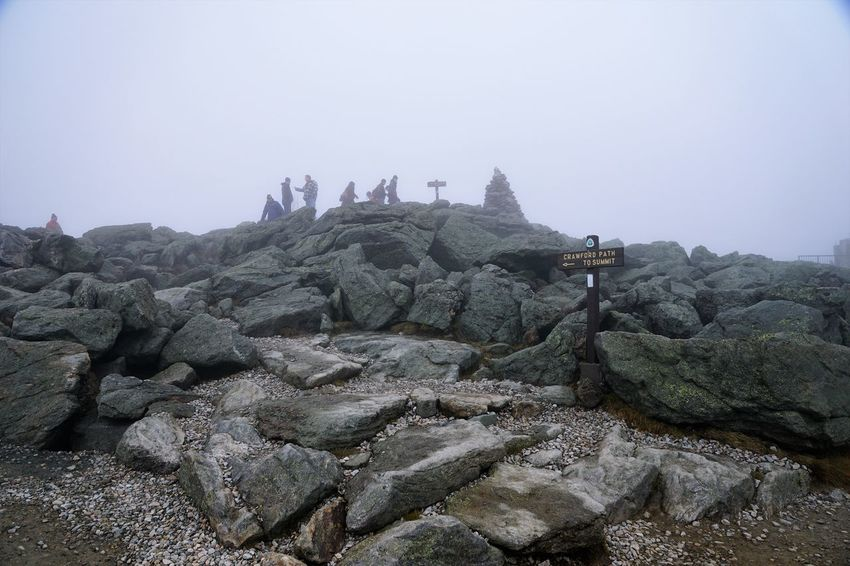 """The Rock Pile"" at the top of Mt. Washington Beauty In Nature Day Fog Men Mountain Mt Washington Nature New Hampshire, USA Outdoors People Real People Rock - Object Rock Pile Scenics Sky Tranquility Travel Destinations Breathing Space"
