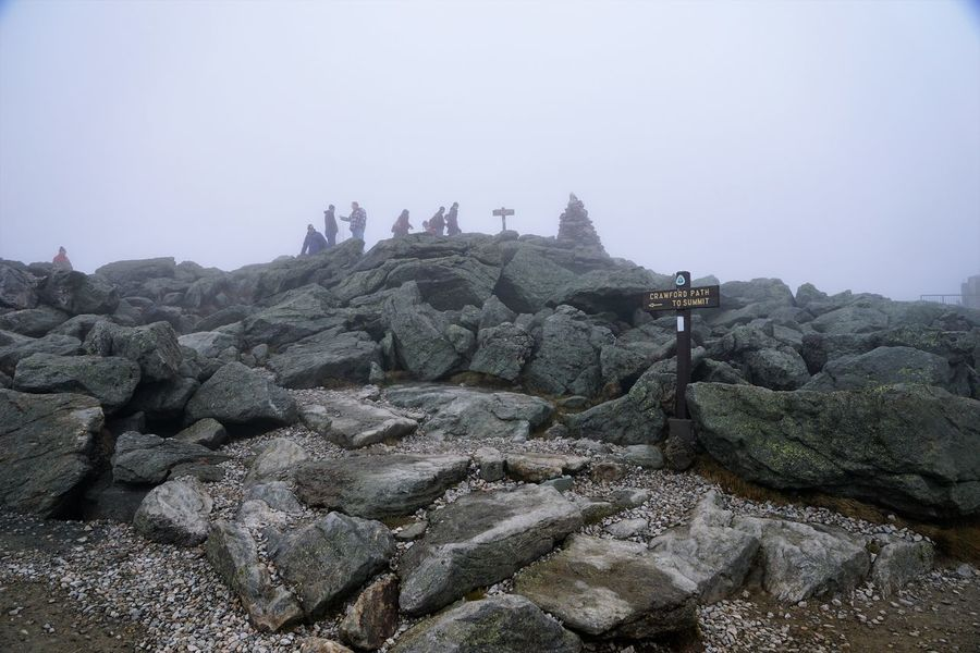 """""""The Rock Pile"""" at the top of Mt. Washington Beauty In Nature Day Fog Men Mountain Mt Washington Nature New Hampshire, USA Outdoors People Real People Rock - Object Rock Pile Scenics Sky Tranquility Travel Destinations Breathing Space"""