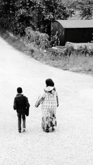 Everyday life, this photo shows a moroccan woman accompanying the child to school , a gesture that every partnt of does routinely in every part of the world regardles from their ethnicity or religion