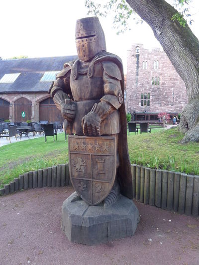 Big Statue. Built Structure Day Footpath History Human Representation Knight In Armour Knight In Armour Carved In Wood. Medieval Staue Made Of Carved Wood. Outdoors Sculpture Statue Statue The Past Tourist. Wood Wooden Wooden Carving.