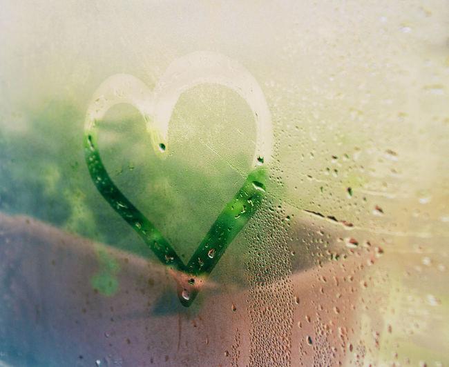 Close-up of raindrops on heart shape