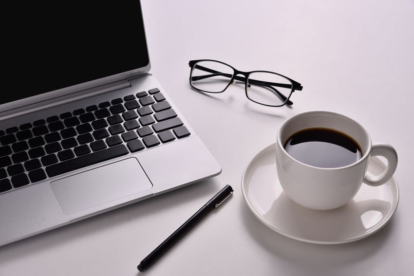 Laptop on the desk with a cup of black coffee and a glasses with a pen placed on side. Cup Pen Glasses 👓 Desk Computer Keyboard Work Opject Business Coffee Notebook Laptop