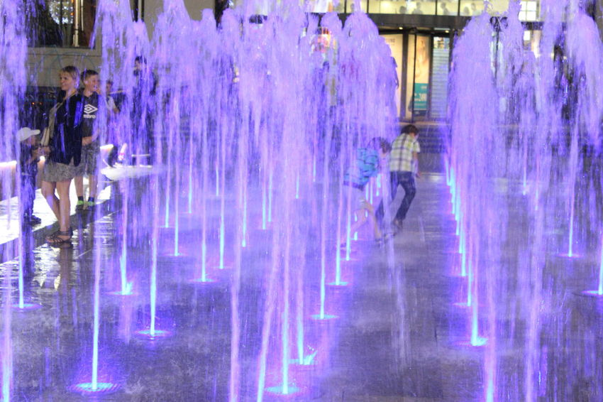 Water Built Structure Illuminated In A Row Spraying Blue Waterfront Order Pink Color Fountain Electric Light Party Outdoors Dark Nightlife Fun