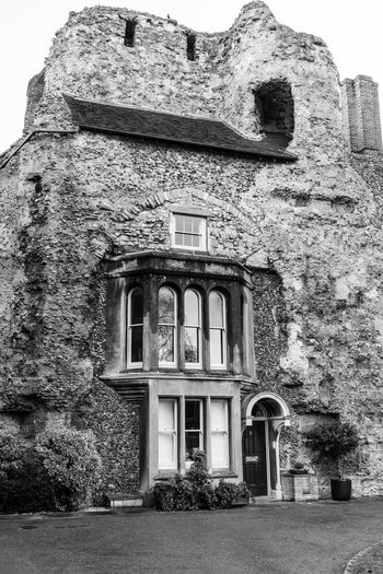 This house is built into the ruins of the old abbey in Bury St Edmunds and is reputedly haunted by ghosts. Haunted House House In The Wall Abbey Walls Built Structure Architecture Building Exterior Building History Old The Past Façade Stone Wall Ruined Old House Historic Building Place Of Interest Black And White Black And White Architecture Bury St Edmunds Bury St Edmunds Abbey Ruins