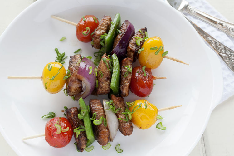 Skewers of chicken and vegetables. Healthy Eating Vegetable Food And Drink Close-up Ready-to-eat No People Multi Colored Studio Photography Yellow Cherry Tomato Scallions Red Onion Cherry Tomatoes UnykaProductions Green Pepper Skewered Chicken Skewers Chicken Grilled Unykaphoto Porcelain  Natural Light Food Stories