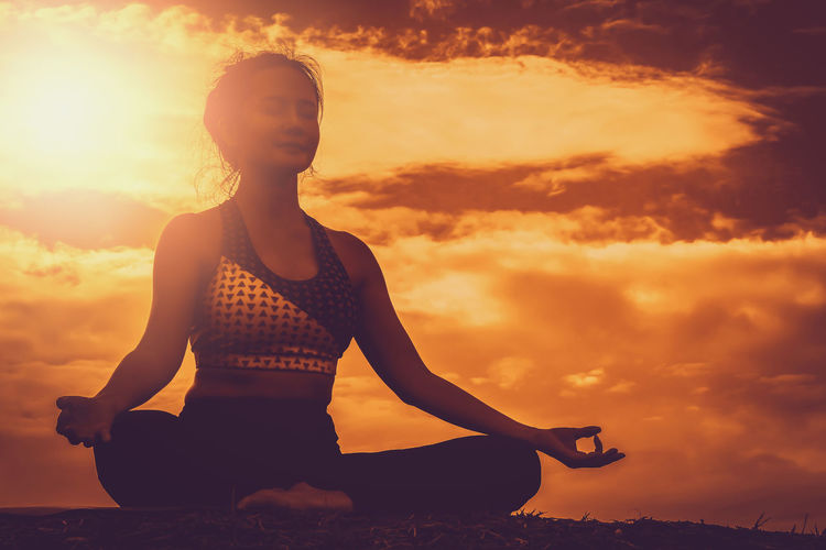 Beautiful women maintain health with yoga exercises. Yoga Sunset Exercising Meditating Lifestyles Sport Healthy Lifestyle Relaxation Exercise Beautiful Woman Posture Relaxation One Person Sky Cloud - Sky Leisure Activity Spirituality Wellbeing Zen-like Cross-legged Real People Nature Orange Color Outdoors Human Arm