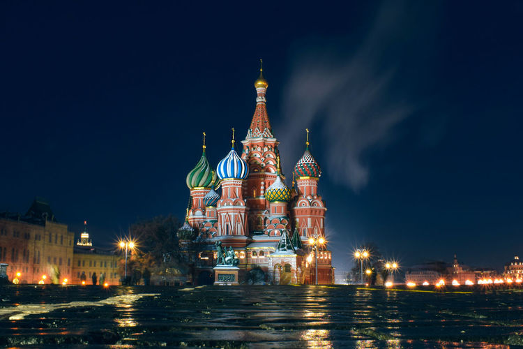 Illuminated cathedral in city at night