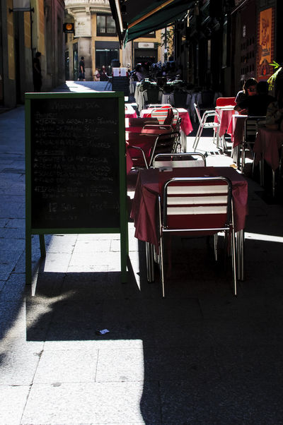 An terrazza in one of the narrown streets of Madrid at the centre of the city. Architecture Cafe Chair Chairs City Day Outdoors Outside Pink Restaurant Seat Sidewalk Cafe Table Terrazza Tourism Travel Travel Destinations Traveling